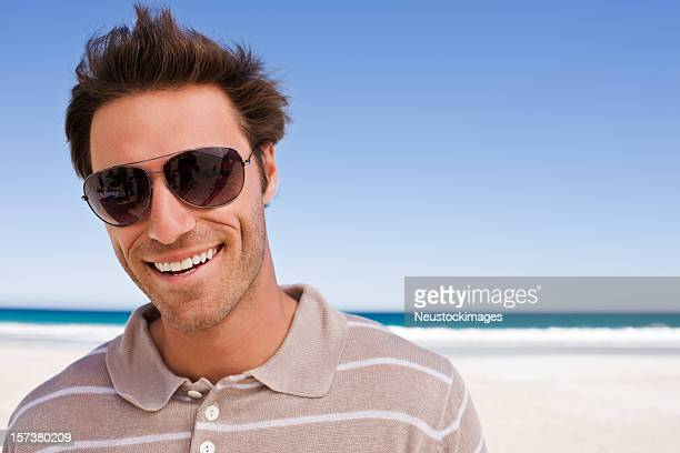 Smiling young man on beach