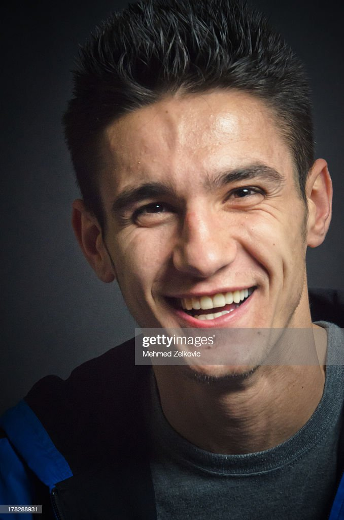 Smiling young man : Stock Photo