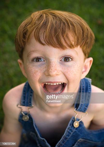 Smiling Young Redhead Boy with Freckles