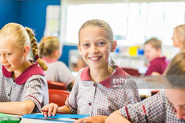 Smiling Young School Girl in a Classroom
