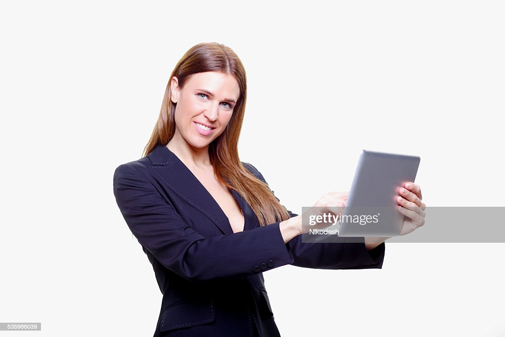 Smiling Young sexy business woman with tablet : Stock Photo