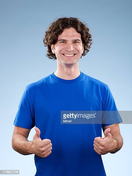 Smiling, young white male with two thumbs up!