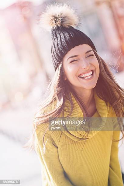 Smiling young woman at sunlight