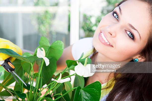 Smiling young woman gardening