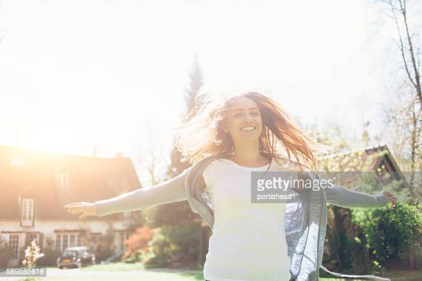 Smiling young woman having fun outdoors