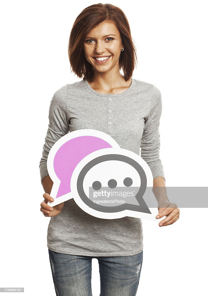 Smiling young woman holding chat sign isolated on white background. : Stock Photo