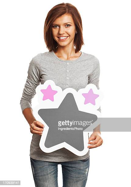 Smiling young woman holding favorites sign isolated on white background.