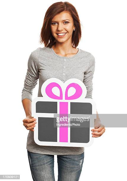 Smiling young woman holding gift sign isolated on white background.