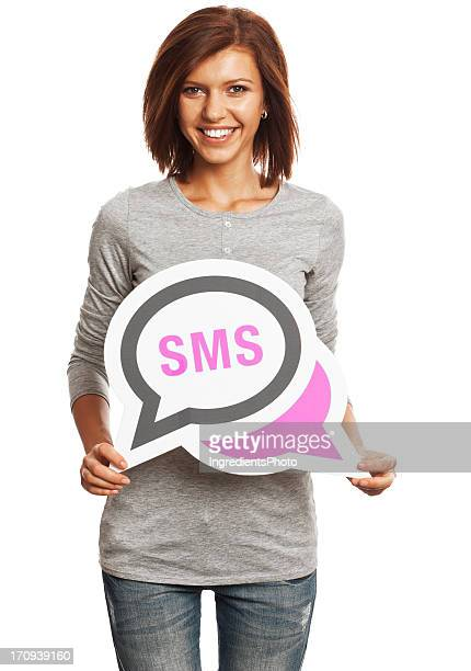 Smiling young woman holding SMS message isolated on white background.