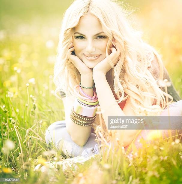 Smiling young woman in meadow