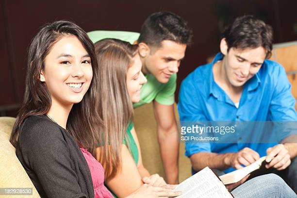 Smiling Young Woman In Middle of Bible Study Group