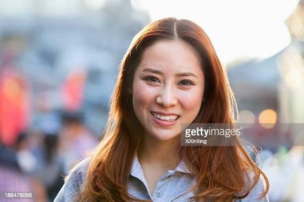 Smiling Young Woman In Nanluoguxiang, Beijing