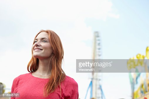 Smiling young woman on a funfair