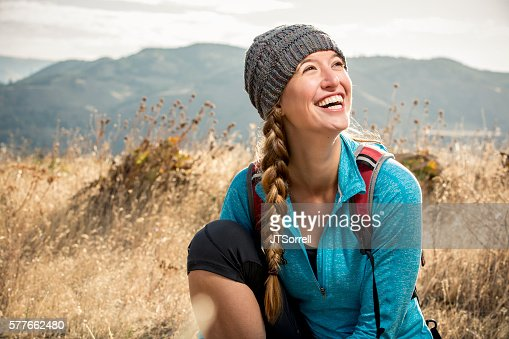 Smiling Young Woman on a Hiking Trail