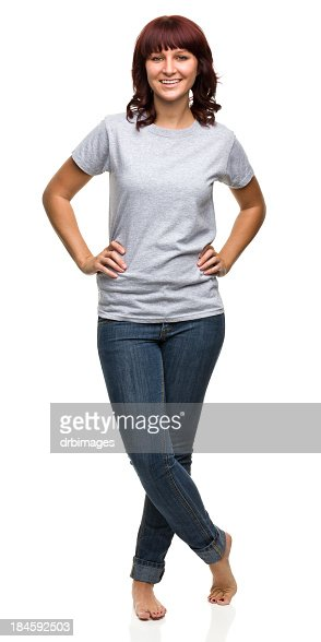 Smiling Young Woman Standing With Legs Crossed