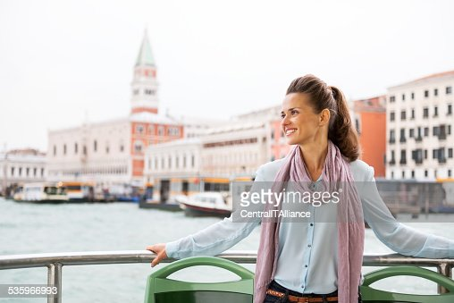 smiling young woman travel by vaporetto in venice, italy : Stock Photo