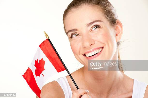 Smiling young woman with Canada flag
