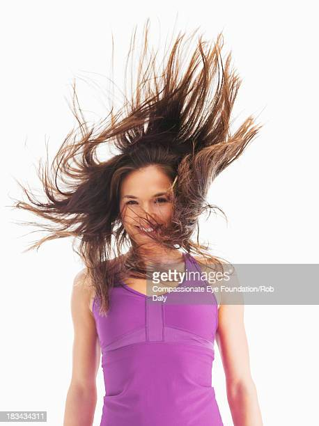 Smiling young woman with hair blowing