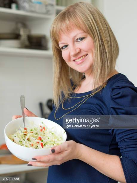 Smiling Young Woman With Salad At Home