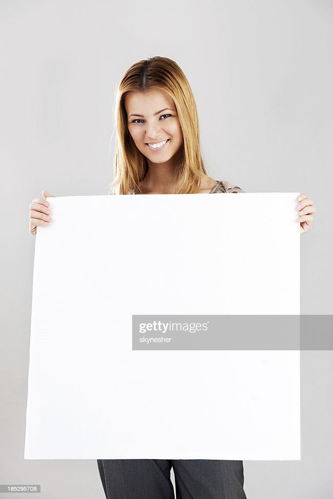Smiling young woman with sign Whiteboard.