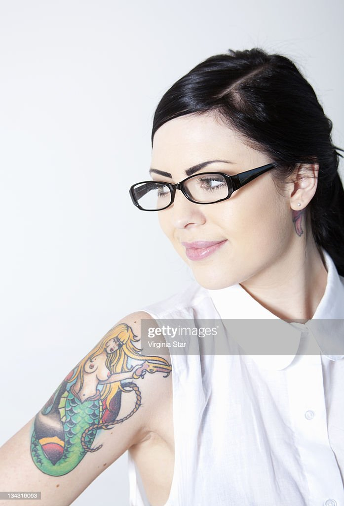 Smiling Young Woman With Tattoo & Glasses : Stock Photo