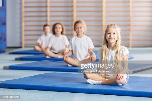 Smilling girl on blue mat : Stock Photo