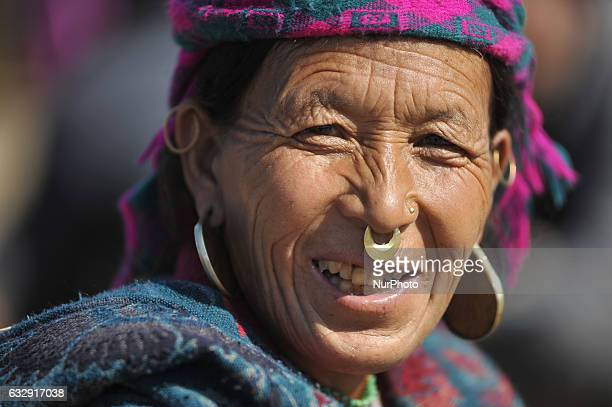 A Smilling portrait of 60 yrs old PARA TAMANGE from Humla come to participate in a parade during celebration of Sonam Losar festival or Lunar New...