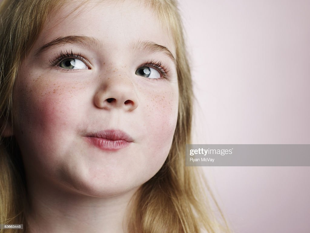 Smirking 4 year old girl.  : Stock Photo