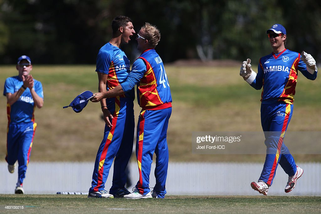 Smit and Craig Williams (R) of Namibia celebrate the wicket of Ifran Karim of Kenya during an ICC World Cup qualifying match between Namibia and Kenya on January 17, 2014 in Mount Maunganui, New Zealand.