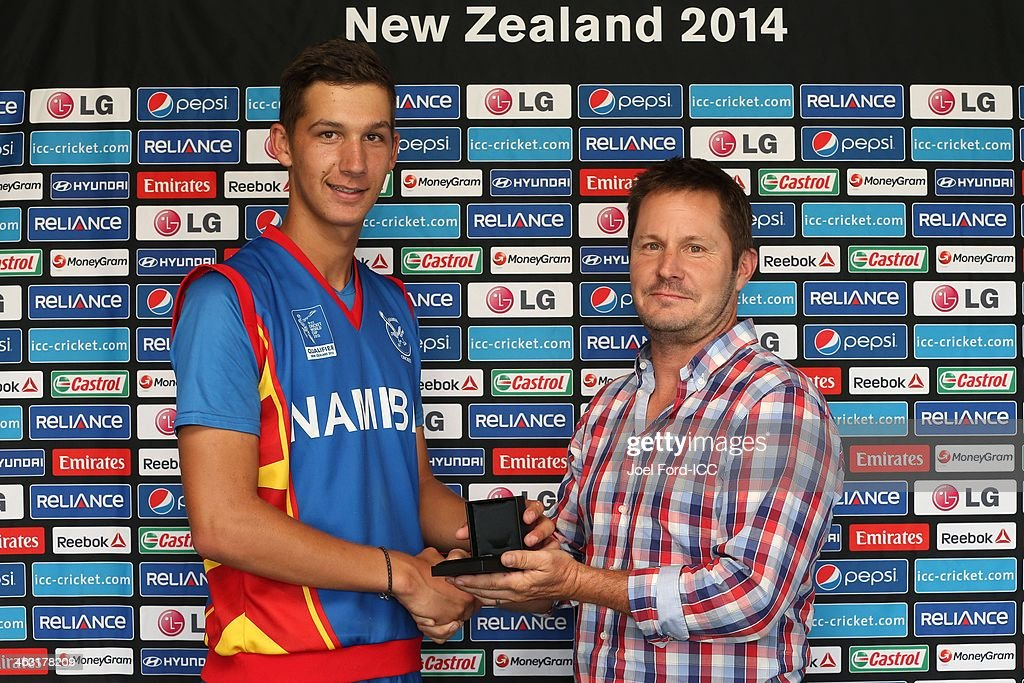 Smit of Namibia receives the man of the match award from Bay Of Plenty Cricket Trust general manager, Kelvin Jones (R) after an ICC World Cup qualifying match between Namibia and Kenya on January 17, 2014 in Mount Maunganui, New Zealand.
