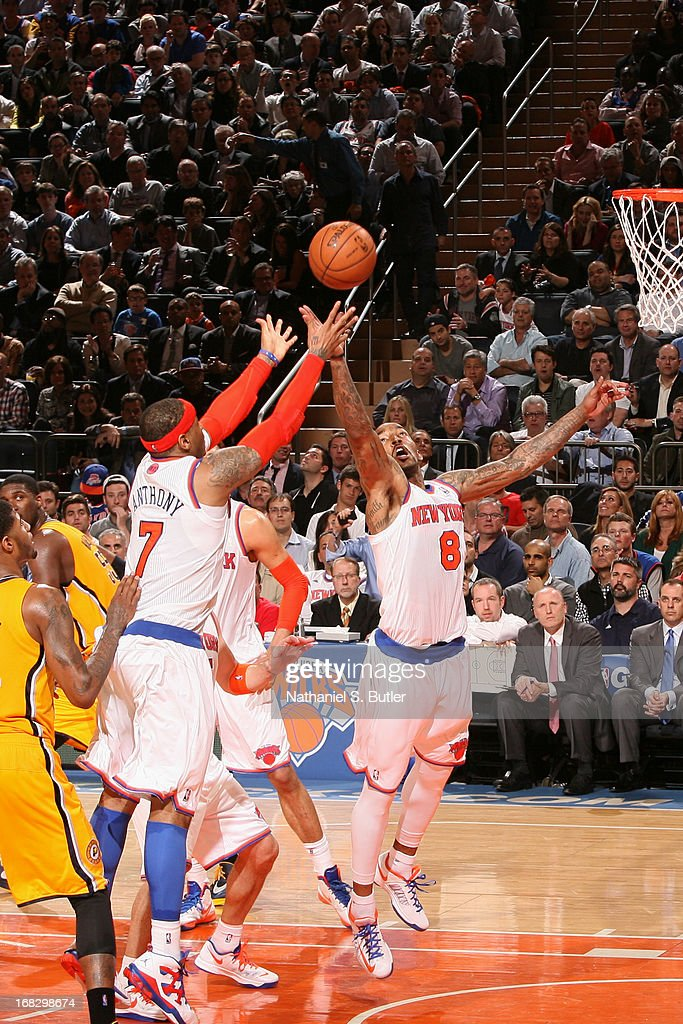 J.R. Smith #8 and Carmelo Anthony #7 of the New York Knicks grabs the rebound against the Indiana Pacers in Game Two of the Eastern Conference Semifinals during the 2013 NBA Playoffs on May 7, 2013 at Madison Square Garden in New York City.