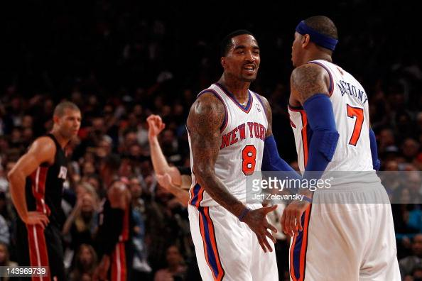 R Smith and Carmelo Anthony of the New York Knicks react after Anthony made a 3point basket to put the Knicks up 8784 in the fourth quarter as Shane...