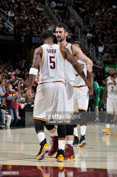 R Smith and Kevin Love of the Cleveland Cavaliers celebrate during Game Three of the Eastern Conference Finals of the 2017 NBA Playoffs on May 21...