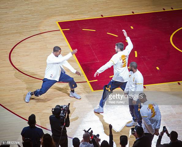 R Smith and Kevin Love of the Cleveland Cavaliers high five before the game against the New York Knicks on October 25 2016 at Quicken Loans Arena in...