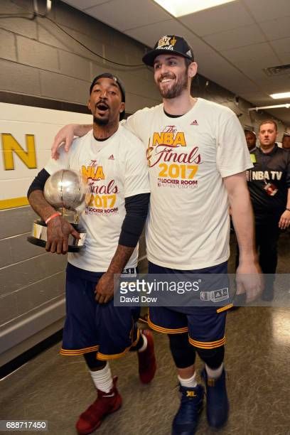 R Smith and Kevin Love of the Cleveland Cavaliers walk off the court after winning Game Five of the Eastern Conference Finals against the Boston...