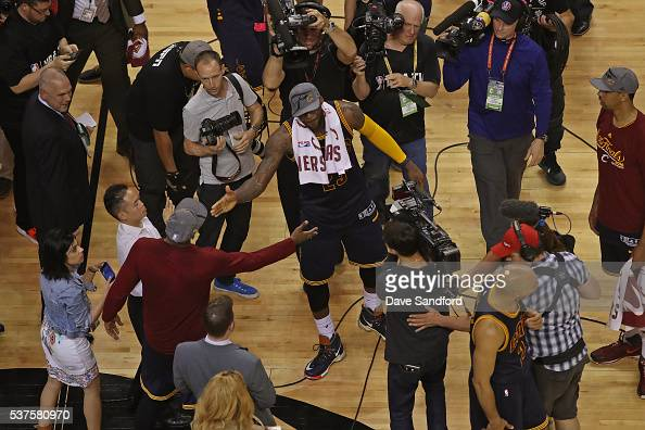 R Smith and LeBron James of the Cleveland Cavaliers shake hands after winning Game Six of the NBA Eastern Conference Finals against the Toronto...