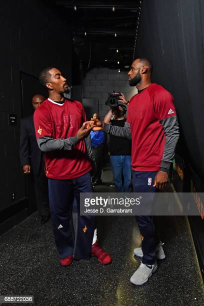 R Smith and LeBron James of the Cleveland Cavaliers shake hands in the hallway before Game Five of the Eastern Conference Finals against the Boston...