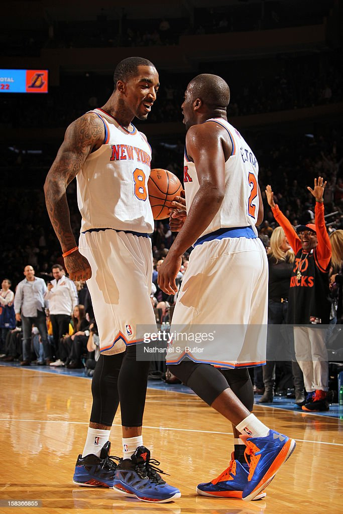 J.R. Smith #8 and Raymond Felton #2 of the New York Knicks celebrate during the game against the Los Angeles Lakers on December 13, 2012 at Madison Square Garden in New York City.