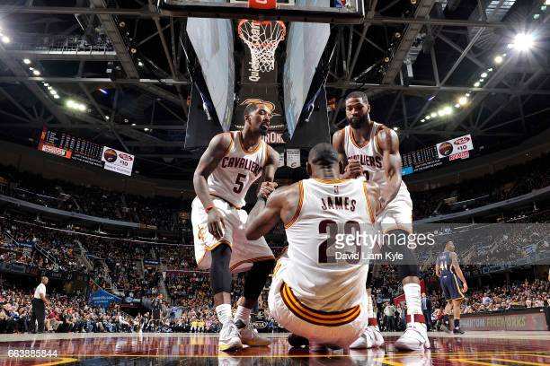R Smith and Tristan Thompson help up LeBron James of the Cleveland Cavaliers during the game against the Indiana Pacers on April 2 2017 at Quicken...
