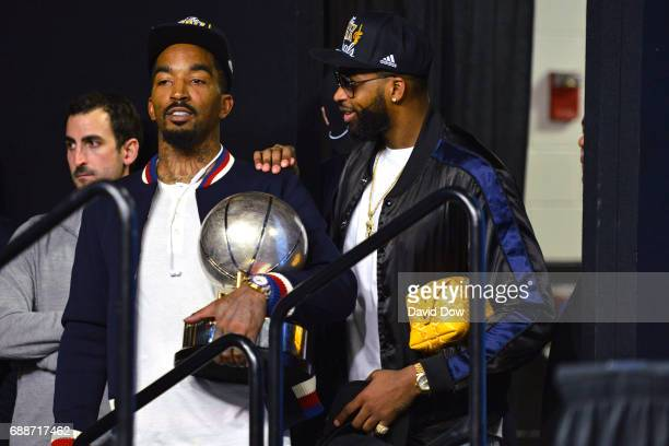 R Smith and Tristan Thompson of the Cleveland Cavaliers wait to go on stage for a press conference after winning Game Five of the Eastern Conference...