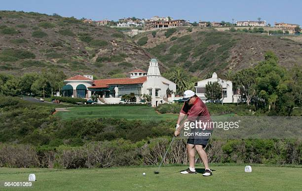 – J Smith from San Diego about to drive ball from 18th tee of North Course Pelican Hill's Golf Course Newport Coast Pelican Hill's Club House and Pro...