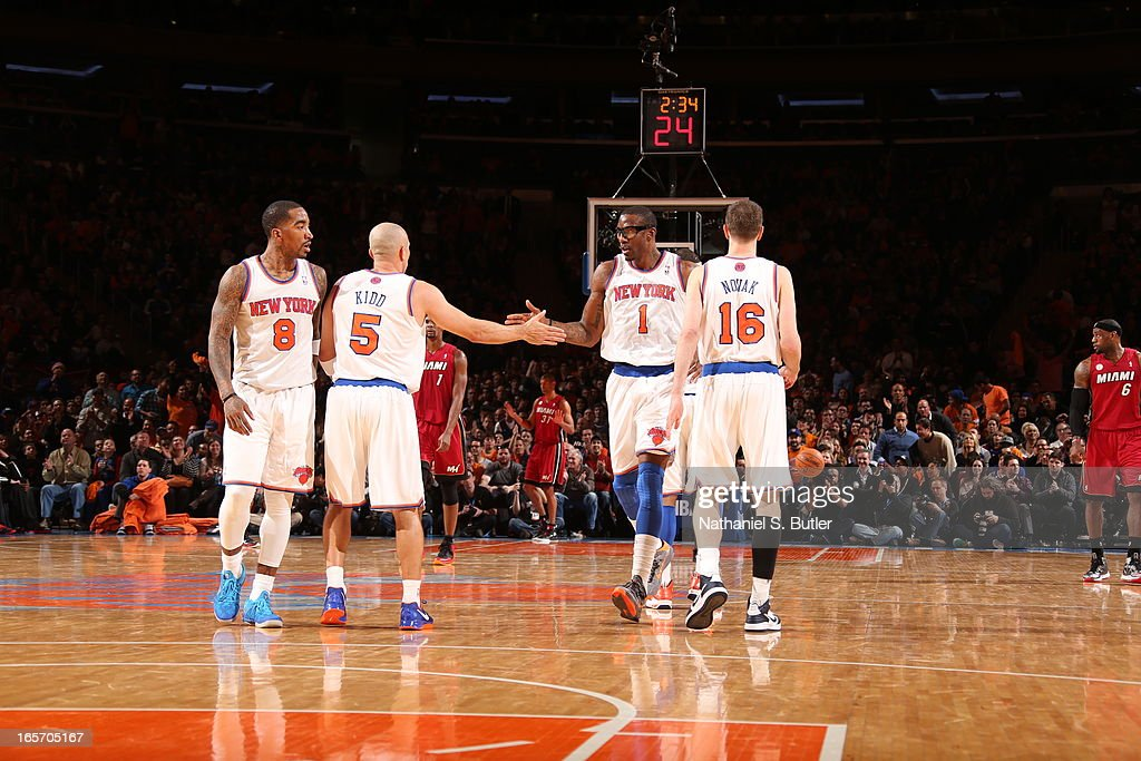 J.R. Smith #8, Jason Kidd #5, Amar'e Stoudemire #1 and Steve Novak #16 of the New York Knicks stand on the court during the game against the Miami Heat on March 3, 2013 at Madison Square Garden in New York City.