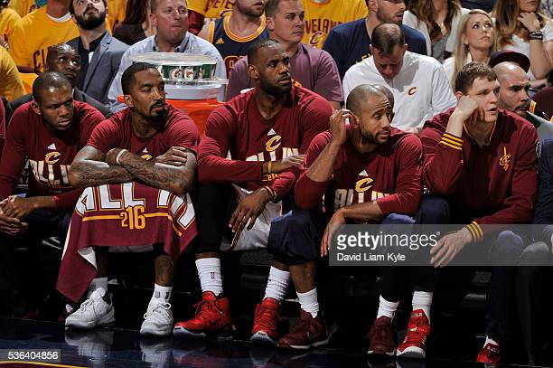 R Smith LeBron James and Dahntay Jones of the Cleveland Cavaliers sit on the bench during Game Two of the Eastern Conference Finals against the...