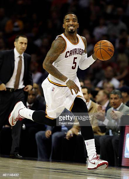 R Smith of the Cleveland Cavaliers advances the ball up court as Cavaliers Head Coach Dave Blatt looks on against the Houston Rockets during the...