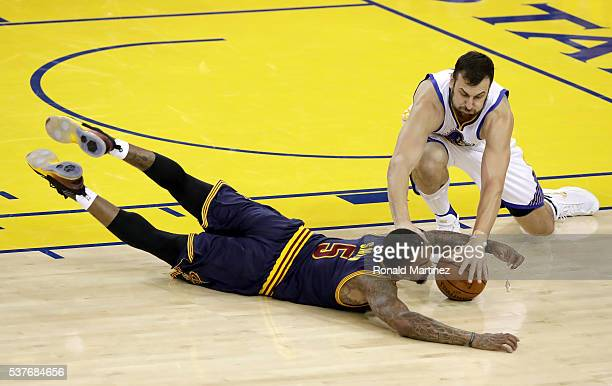 R Smith of the Cleveland Cavaliers and Andrew Bogut of the Golden State Warriors go after a loose ball in the first half in Game 1 of the 2016 NBA...
