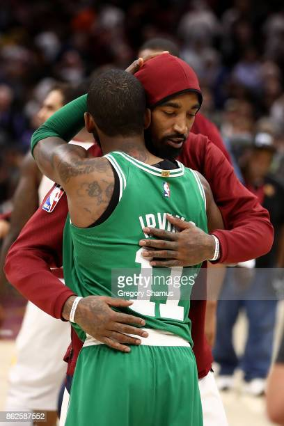 Smith of the Cleveland Cavaliers and Kyrie Irving of the Boston Celtics shake hug after a Cavaliers 10299 victory at Quicken Loans Arena on October...