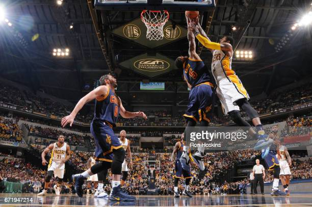 R Smith of the Cleveland Cavaliers blocks a shot by Paul George of the Indiana Pacers during Game Four of the Eastern Conference Quarterfinals of the...