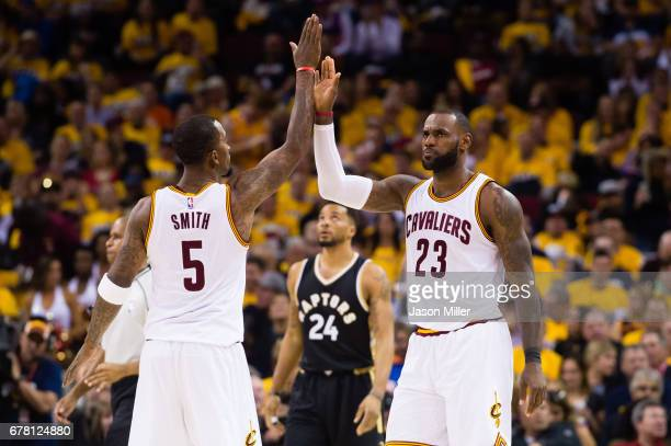 Smith of the Cleveland Cavaliers celebrates with LeBron James during the second half of Game Two of the NBA Eastern Conference semifinals against the...