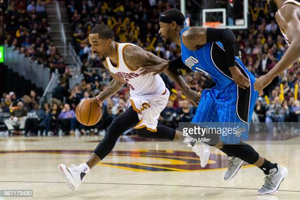 Smith of the Cleveland Cavaliers drives around Terrence Ross of the Orlando Magic during the second half at Quicken Loans Arena on April 4 2017 in...