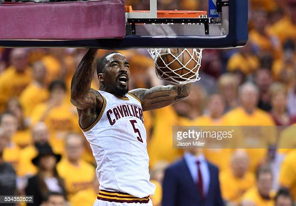 R Smith of the Cleveland Cavaliers goes up for a dunk in the first quarter against the Toronto Raptors in game five of the Eastern Conference Finals...